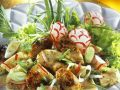 Bavarian Dumplings with Sausages and Radish Salad recipe