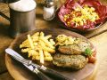 Beef Steaks with Fries and Salad recipe