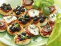 Mini Olive, Mozzarella and Ham Pizzas recipe