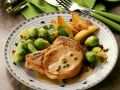 Pork Chops with Baked Potatoes, Brussel Sprouts and Pepper Sauce recipe