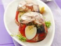 Aspic with Quail Egg, Ham, Olives and Peppers recipe