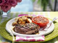 Bacon Wrapped Beef Steaks with Potatoes and Tomatoes recipe