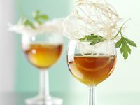 Beef Consomme with Egg Yolks and Glass Noodle Crisps recipe