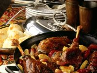 Braised Goose Legs with Apples and Plums recipe