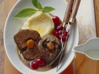Braised Wild Rabbit Leg with Buttermilk Gravy and Cherry Sauce