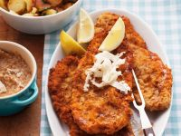 Breaded Cutlets with Potatoes recipe