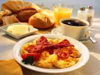 Breakfast with Scrambled Eggs and Bacon, Coffee, Orange Juice and Rolls recipe