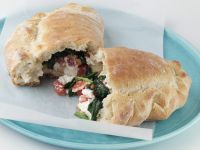 Calzone Filled with Mozzarella, Tomatoes, and Spinach recipe