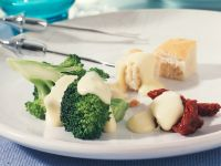 Cheese Fondue with Marinated Broccoli and Dried Tomatoes recipe