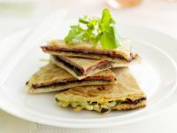 Flatbread Triangles with Salami and Olives recipe