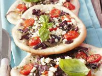 Flatbreads with Vegetables, Anchovies and Feta Cheese recipe