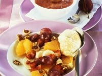 Fruit Salad with Frozen Cream and Warm Plum Sauce recipe
