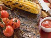 Grilled Steak with Corn on the Cob, Cherry Tomatoes and Potatoes recipe