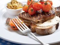 Grilled Steaks with Goat Cheese Toast and Roasted Tomatoes recipe