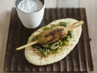 Ground Pork Skewers with Pea Salad Served on Pita Bread recipe