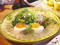 Hard-boiled Eggs with Caviar and Salad recipe