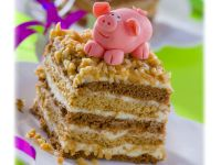 Hazelnut and Chocolate Layer Cake Slices with a Marzipan Pig