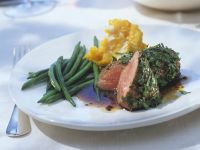 Herb Crusted Roast Lamb with Green Beans and Pumpkin Puree recipe