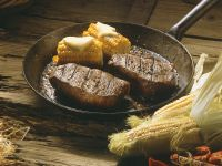 Herb-marinated Steaks with Corn on the Cob recipe