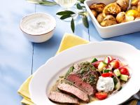 Lamb Steak with Salad and Baked Potatoes recipe
