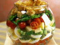 Layered Salad with Cheese, Eggs and Croutons recipe