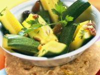 Marinated Zucchini with Almonds and Raisins recipe