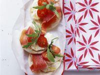 Mini Pizzas with Tomato, Mozzarella, Prosciutto, and Arugula recipe