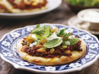 Moroccan Pizza with Ground Lamb and Pine Nuts recipe