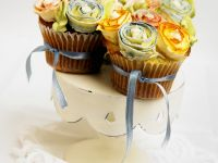 Orange Flavored Cupcakes Decorated with Flowers and Ribbons recipe