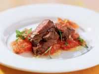 Ostrich Steak with Tomatoes recipe