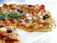 Pizza with Meat and Black Olive Toppings recipe