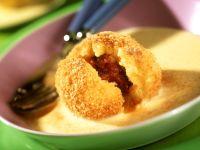 Plum Dumplings with Custard Sauce recipe