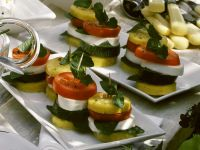 Polenta Rounds with Mozzarella, Zucchini and Tomato recipe