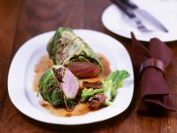 Pork Filet Wrapped in Savoy Cabbage with Mushroom Jus recipe
