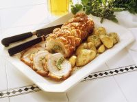 Roast with Herb Stuffing and Potatoes recipe