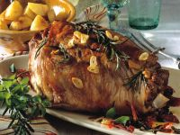 Roasted Leg of Lamb with Herbs, Tomatoes and Olives recipe