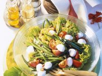 Salad with Green Beans, Mozzarella, Tomatoes, Pine Nuts and Raisins recipe