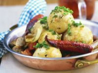 Sausages with Sauerkraut-Potato Dumplings recipe