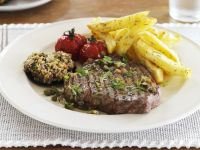 Seared Steaks with Breaded Mushrooms, Roasted Tomatoes and French Fries recipe