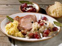 Smoked Pork Chops with Potato Puree, Sauerkraut and Grapes recipe