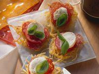 Spaghetti Nests with Tomatoes, Mozzarella and Salami recipe