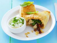 Spinach Pastries with Chicken and Raisins recipe