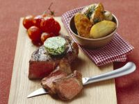 Steak with Herb Butter, Baked Potatoes and Tomatoes recipe