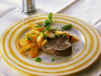 Steaks with Carrots and Basil recipe