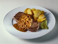 Steaks with Onion Sauce and Roast Potatoes recipe