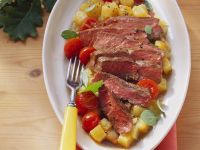 Steaks with Potatoes and Tomatoes recipe