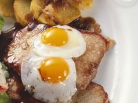Veal Schnitzel with Hash Browns, Green Beans and Fried Quail Eggs recipe
