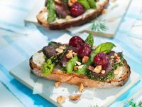 Venison Tenderloin with Asparagus and Cherries on Brown Bread