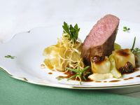 Venison Tenderloins with Raisin Sauce and Potato Packets recipe