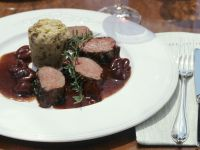 Venison with Mushroom Bread Pudding and Cherry Sauce recipe